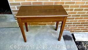 SMALL TABLE OR PIANO STOOL