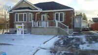 Ritson and 401 -Newly renovated 3 bedroom upper level bungalow