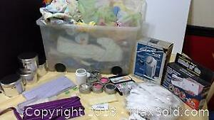 sewing items, including a bin of materials