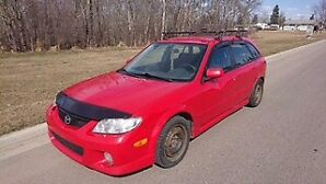 Mazda Protege 2003 has all season tires and winter tires on rims