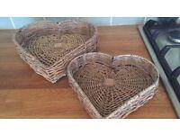 Two heart shaped wicker baskets