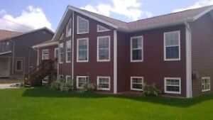 New Listing! Chalet style 4 bdrm with 1 bdrm apt! $329,900