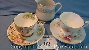 2 sets of china cups & saucers (with gold edges) + creamer