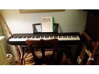 Electric piano. Yamaha piano with stand