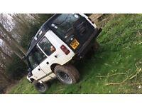 White 4x4 Land Rover
