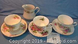 3 sets of china cups & saucers with gold edges + creamer