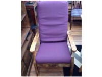 A high back wooden chair with cushions