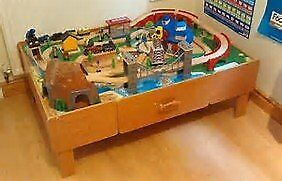 Universe of Imagination Train Table. Loads of track, trains, carriages, people, stations, bridges.