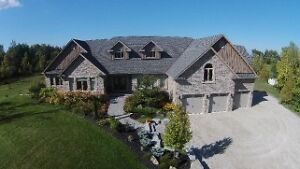 Stunning Executive Home on 12 Acres with a Pond
