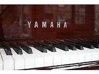 upright piano by yamaha in a mahogany gloss case