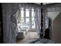 Double en-suite room with balcony and sea views , four poster bed corner bath £175 pwk