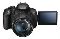 canon rebel t5i with two lenses and bag.