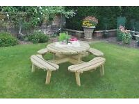 circular wooden garden set painted in a light pastel green colour. Seats 8 people