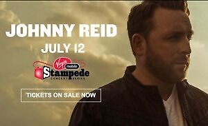 2 floor seat tickets to Johnny Reid