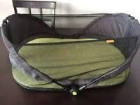 Munchkin fold and go travel bassinet