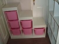 IKEA Trofast storage unit with pink boxes