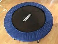 Small, blue trampette/personal trampline