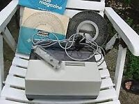 "BOOTS TH 150 A"" AUTOMATIC SLIDE PROJECTOR BOXED IN EXCELLENT CONDITION WITH SLIDES"