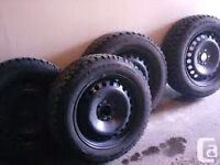 Tires with rims from a 2012 mazda 3