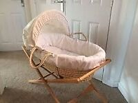 Mamas and Papas Moses Basket and Stand, comes also with sheets, blanket and mattress.