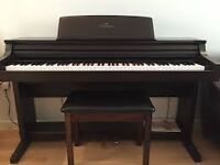 Yamaha Clavinova CLP-155, black, excellent condition, includes stool.