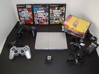 2 plastion 2 console (1slim silver) (1black normal) 2 controllers + plus games (wires inluded)