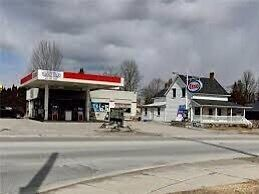 Esso gas station for sale with property.