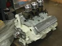 WANTED:     TRI - POWER  FOR  394  OLDSMOBILE.