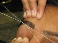 Threading Facial hair removal