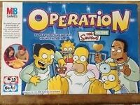 Simpsons Operation still in box with wrapping (although wrapping is torn)