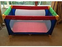 hauck multi coloured travel cot