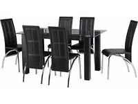 Really nice BRAND NEW glass dining table with 6 chairs. can deliver