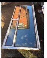 Wood framed metal window
