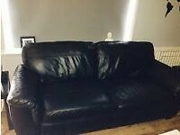 Free used black leather sofa