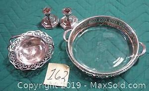 Silver plated: candle sticks, candy dish with handle, pie holder with glass pie plate