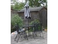 Garden table, four chairs and parasol set, great condition, just £8!