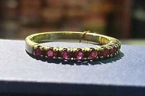 14k Gold Ring with red gemstones $295