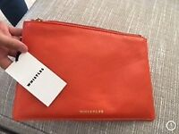Whistles orange clutch bag