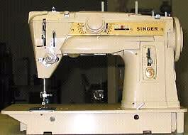 Singer Sewing machine in a wooden table for sale.