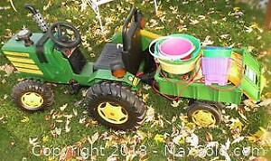 Pedal tractor with wagon and toys