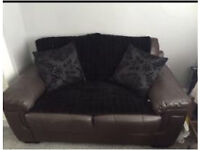 Brown three seater and two seater leather sofa