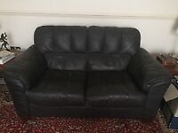 Two leather-type sofas, three and two seater, fair condition, free