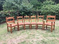 6 Chunky Wooden Dining Chairs, including 2 carvers; leather seats.