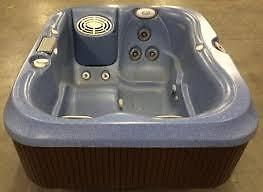 compact Jacuzzi® J-315™ (120v or 220v)  Hot Tub  provides a private, intimate setting with enough room for two to three