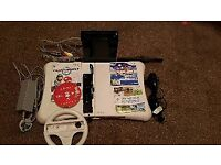 Nintendo Wii with fit board and 4 games