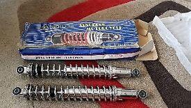 Motorcycle adjustable rear shock absorbers