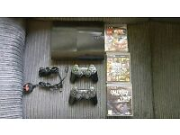 PS3 - PlayStation 3 with controllers and games