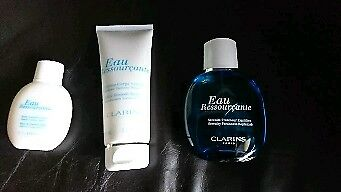 New Clarins Eau Ressourçante bath crème, body lotion and energising spray in good sized wash bag