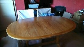 Immaculate extendable wooden table