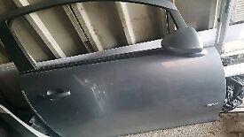 Corsa d driver door in light blue